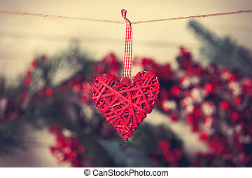 Heart shape toy hanging on the thread