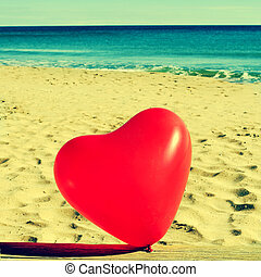 heart-shaped balloon - a red heart-shaped balloon on a...