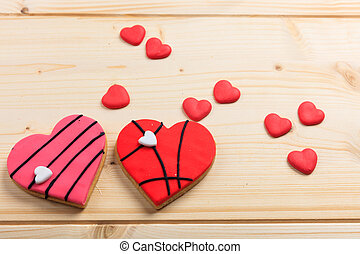 Heart shaped biscuits on wooden background