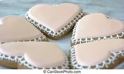 Heart-shaped biscuits with pink icing. Cut out sugar cookies...