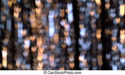 Heart shaped blinking lights. Bokeh background