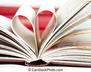 Heart shaped book pages - Close up on heart shaped book...
