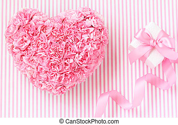 Heart shaped bouquet of pink carnations with gift box