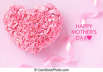 Heart shaped bouquet of pink carnations with pink ribbon for mother's day