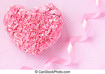 Heart shaped bouquet of pink carnations with pink ribbon