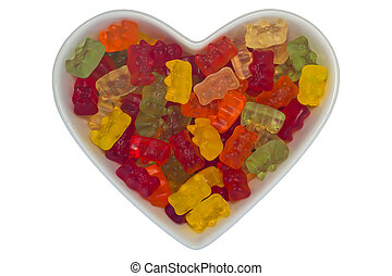 Heart-shaped bowl filled with gummy bears, isolated on white background