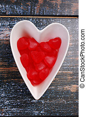 heart shaped bowl with red candies for valentines