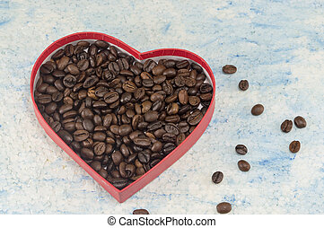 Heart shaped box filled with coffee beans
