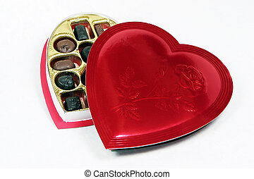 Heart shaped box of candy with lid partially on - Heart ...