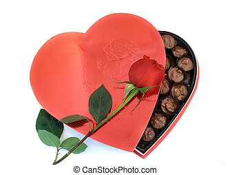 Heart shaped box of nuts chocolates with a Rose. Perfect for Valentine's Day.