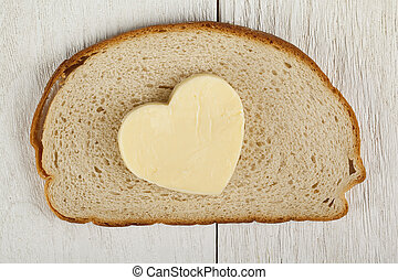 heart shaped butter on bread - Closed up shot of a piece of ...