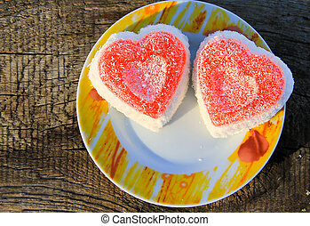 Heart shaped cake on wooden background