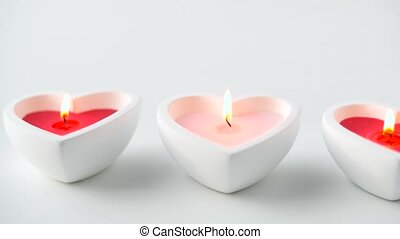 heart shaped candles burning in st valentines day - st...