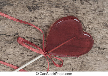 heart shaped candy on a wooden background
