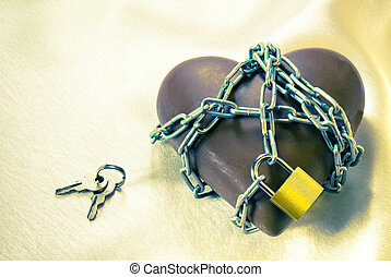 Heart shaped chocolate tied up with chains with lock and keys