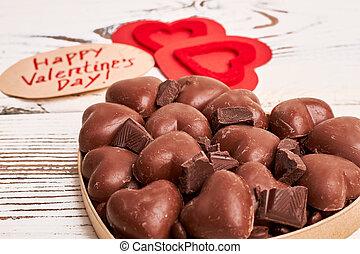 Heart-shaped chocolates in box.