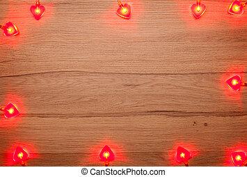 Heart shaped Christmas lights on wood