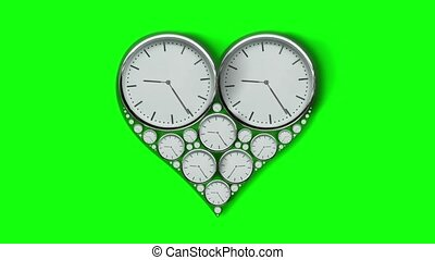 Heart-shaped clocks on the green screen in timelapse