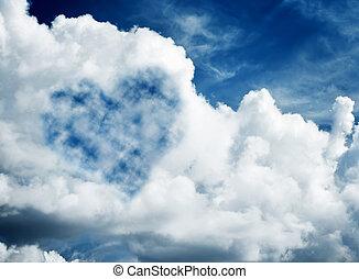 Heart shaped cloud on blue sunny sky.