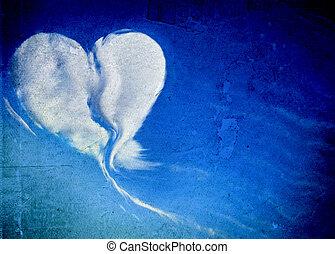 Heart shaped cloud on blue sky