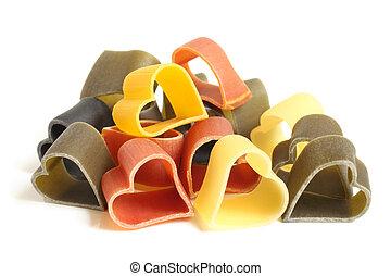 Heart-shaped colored Italian pasta