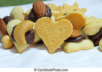 heart-shaped cookie cutter and almond nuts.