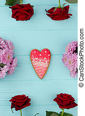 Heart shaped cookie on wooden background.