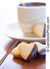 Heart shaped cookies and a fresh cappuccino