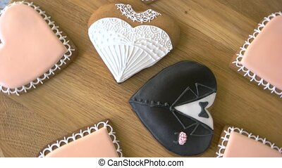 Heart shaped cookies on wooden background. Decorated biscuits for wedding day. Celebrate your love with sweets.