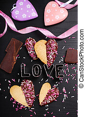 heart shaped cookies with chocolate and sprinkles