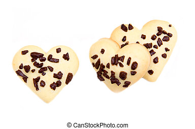 Heart-shaped cookies with chocolate on white background seen from above