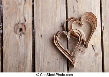 Vintage book heart shaped cutout on rough wood board texture background