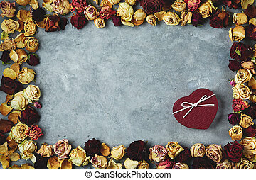 Heart shaped gift box on the gray concrete background