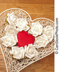 Heart shaped gift box with roses