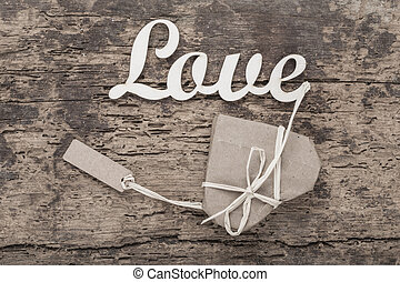heart shaped gift with name tag on wood