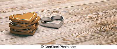 Heart shaped gingerbread cookies and cutter, wooden background, banner