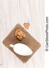 Heart shaped gingerbread cookies and milk pitcher
