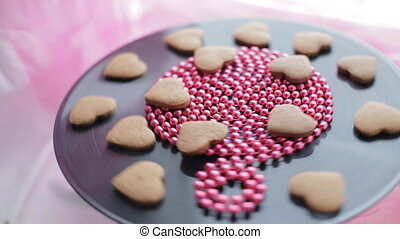 Heart-shaped gingerbread cookies rotation - Valentine's day...