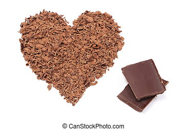 Heart shaped grated chocolate on white background