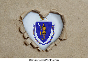 Heart shaped hole torn through paper, showing Massachusetts flag