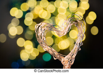 Heart shaped holiday blurred bokeh background. Valentine backgro