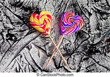 Heart shaped lollipops on it is black white background