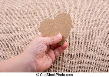 Heart shaped object in hand