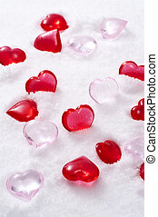 Heart shaped object on snow background