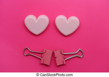 Heart shaped paper clips, pink on rose