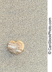 Heart shaped pebble on the beach