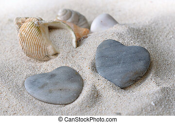 heart shaped pebbles - two heart shaped pebbles on the sand...
