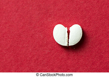 Heart shaped pill cracked in half - Broken heart shaped pill...