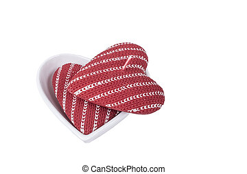 heart shaped red candles isolated on white