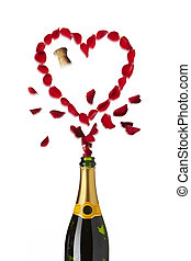 Heart shaped red rose petals popping out of champagne bottle